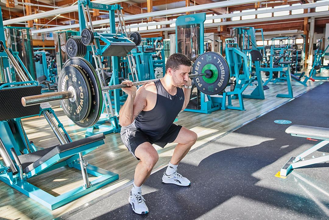 Fitness-Trainer-Gewichte